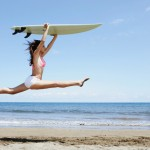 Woman Jumping with a Body Board